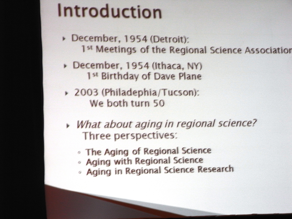 "A slide of Prof. Plane\'s address on ""What about Aging in Regional Science?\"""
