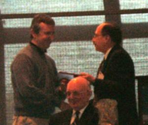 Dr. Duranton receives his award from NARSC President James LeSage