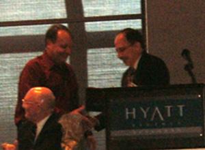 Dr. Jackson receives his award from NARSC President James LeSage