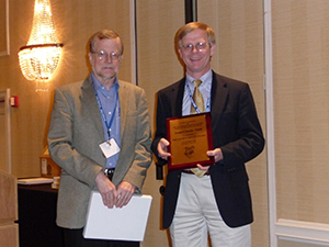 Jean-Claude Thill (right) recieving a plaque from Vernon Henderson